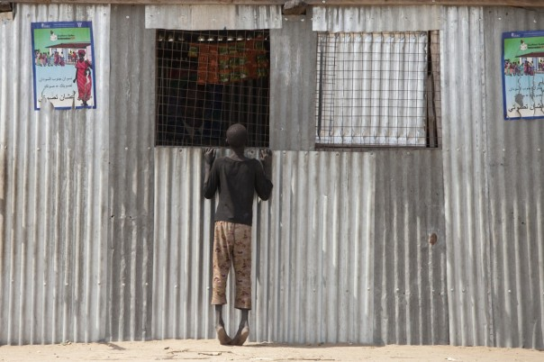 A boy looks in the window of a polling place shortly before independence in South Sudan.