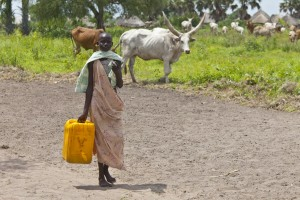 A woman carries water in the village of Panwel South Sudan.
