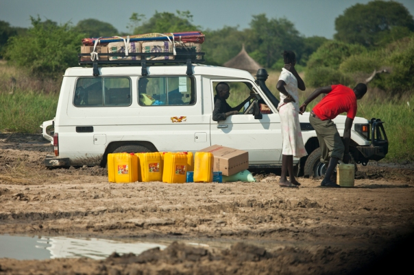 Toyota being unloaded to try to get it out of the mud, South Sudan.