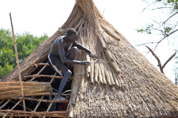 A man fixing his roof in South Sudan. How many of us would find it this easy?