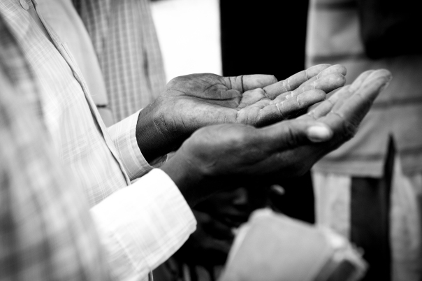 The hands of a Sudanese man in prayer.