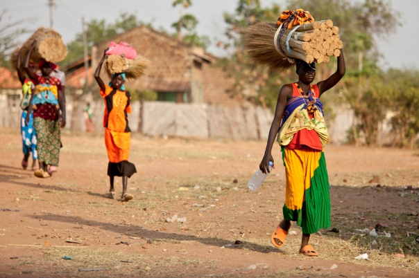 Women carrying thatch for a new roof in Torit, South Sudan.