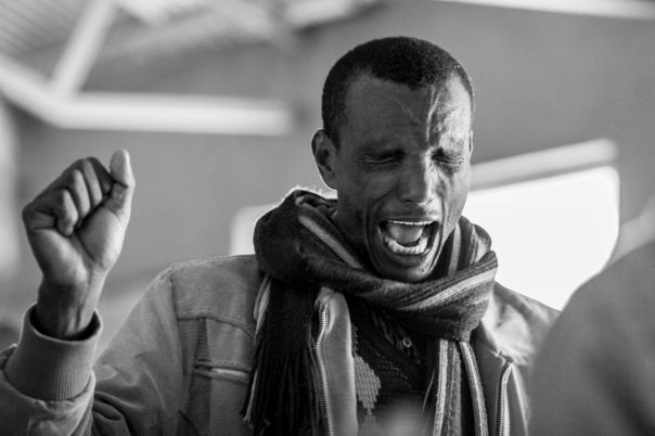 An Ethiopian pastor deep in prayer.