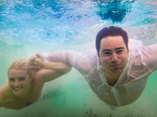 The bride and groom in an underwater shoot I did for them.