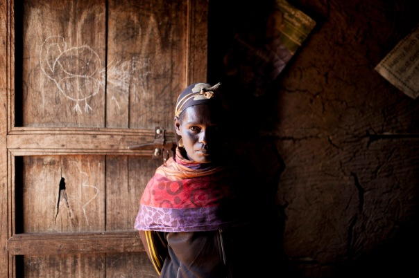 Visiting an Ethiopian widow in her home.