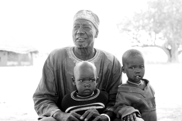 The chief with one of his children and one of his grandchildren.
