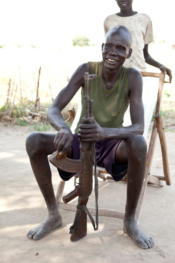 A South Sudanese man cleans his gun.