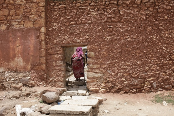 A woman entering the old city of Harar through the hyena gate.