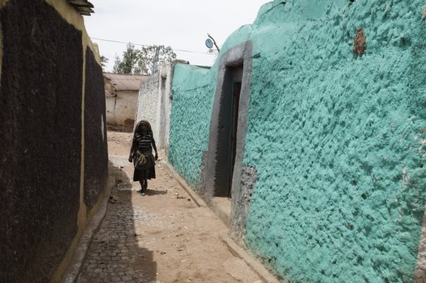 A woman walks down the street in Harar, Islam's fourth holiest city.