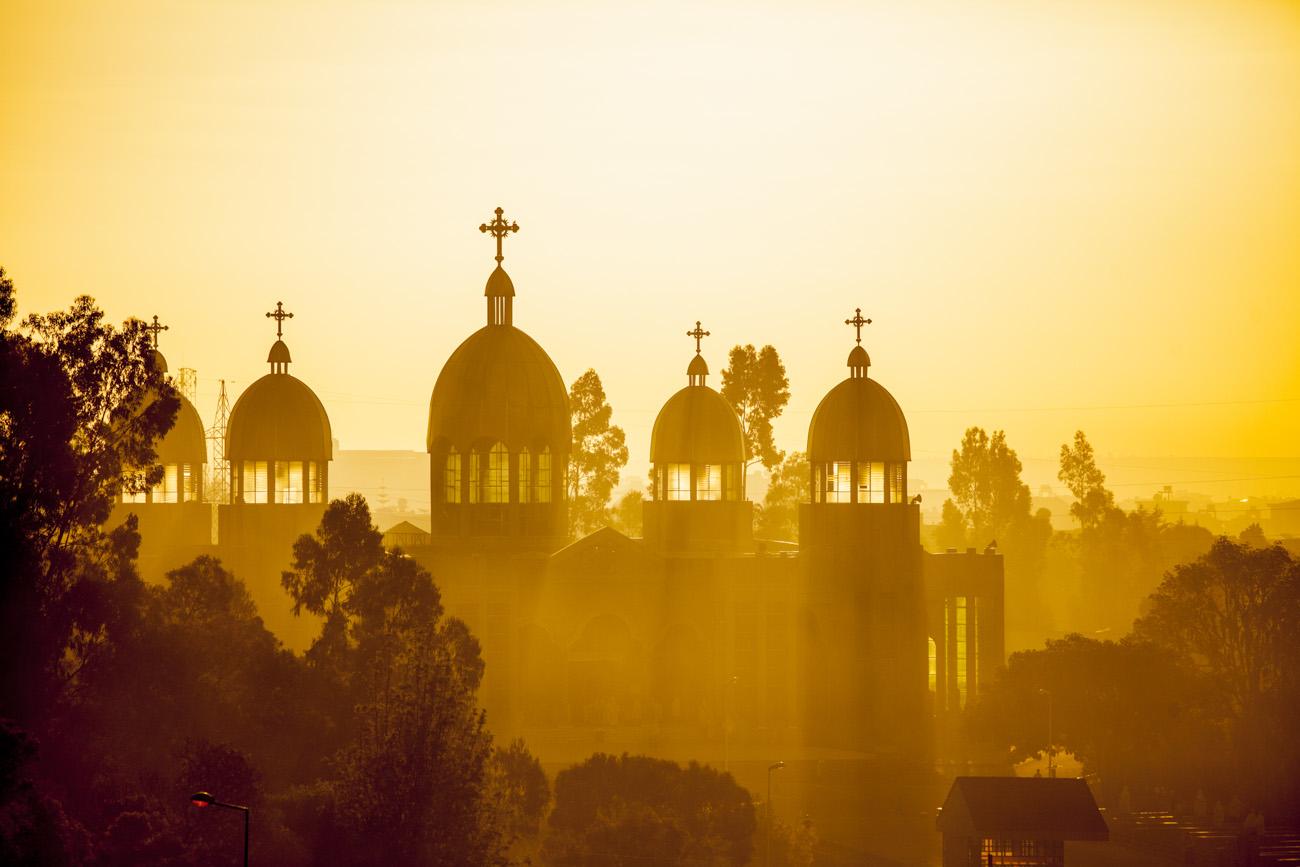 Ethiopian Orthodox church backlit by morning sun rays in Addis Ababa, Ethiopia