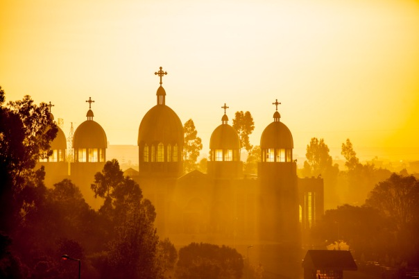 Ethiopian Orthodox church backlit by morning sun rays in Addis Ababa, Ethiopia