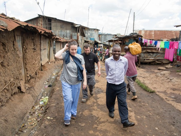 Bunny and Obedi walking through Kibera.