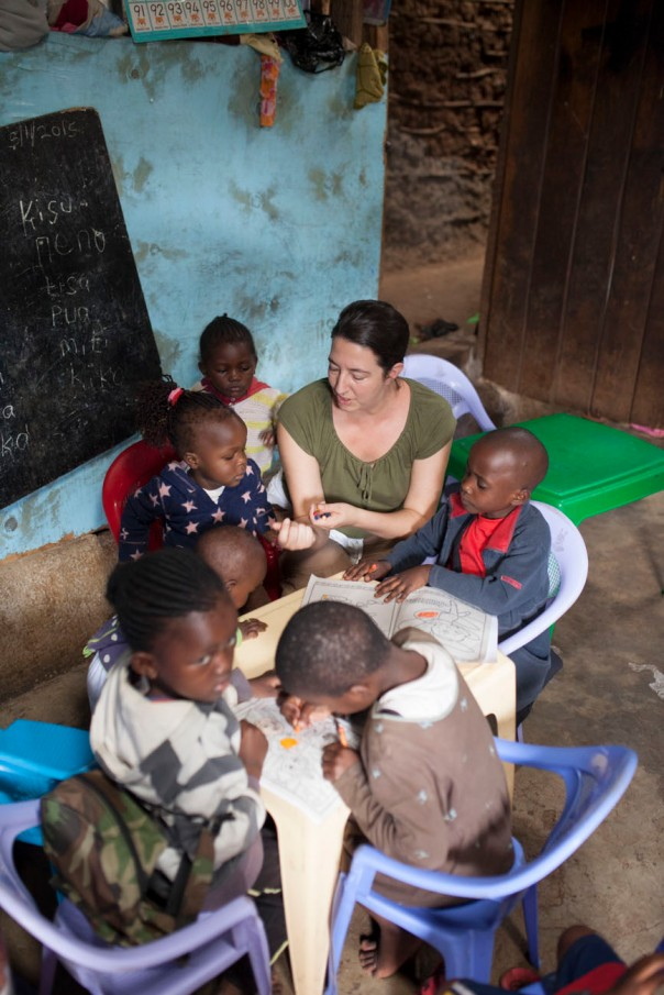 Lynn in her element, teaching the kids, and trying to learn some Swahili.